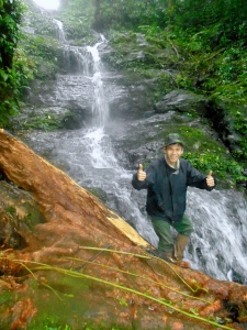 Den, a WWF colleague, in front of a waterfall